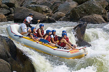 negotiating a rapid while rafting on the Barron River near Cairns